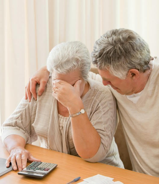 sad-mature-couple-calculating-their-domestic-bills-s (1)